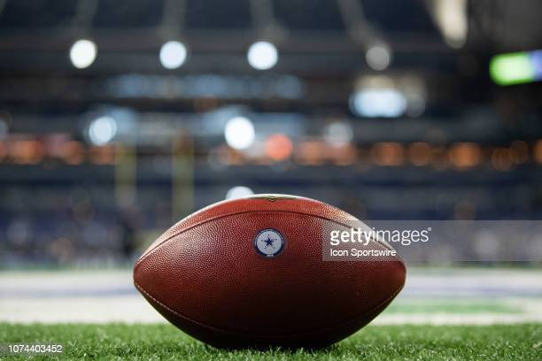 Football with the Dallas Cowboys logo on the field before the NFL game between the Indianapolis Colts and Dallas Cowboys on December 16 at Lucas Oil...