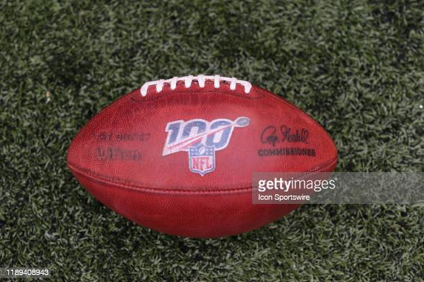 A football with the NFL 100 logo sits on the field during the game against the New England Patriots and the Cincinnati Bengals on December 15th 2019...
