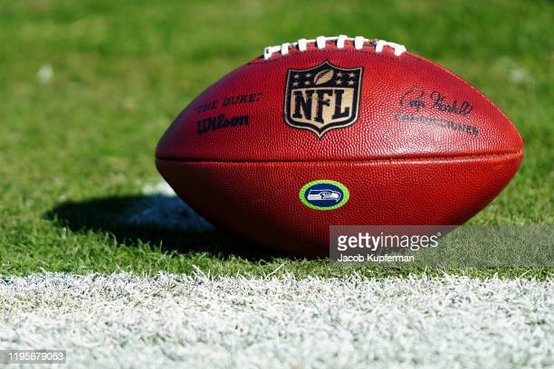A football with the NFL logo and the Seattle Seahawks logo before their game against the Carolina Panthers at Bank of America Stadium on December 15...