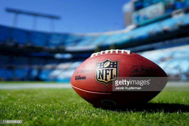 A football with the NFL logo before the game between the Carolina Panthers and the Tennessee Titans at Bank of America Stadium on November 03 2019 in...