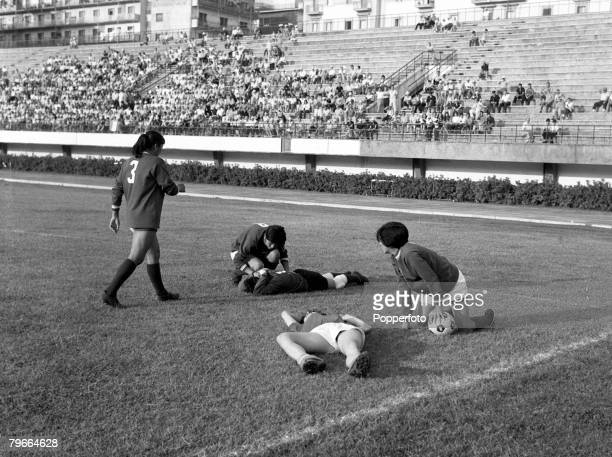 Football, Women's World Cup Semi Final, Naples, Italy, 11th July 1970, Mexico's goalkeeper holds her head after a collision with an Italian player...