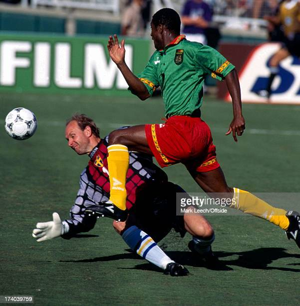 Football World Cup 1994 Cameroon v Sweden Omam Biyick lifts the ball over Thomas Ravelli to score a goal for Cameroon