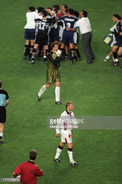 Football World Cup 1998 Argentina v England A dejected David Batty leaves the pitch after missing a penalty as the Argentine players celebrate