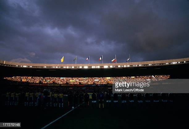Football World Cup 1998 Brazil v Chile Storm clouds gather over the Parc de Princes as sunlight is cast across the fans in the stadium