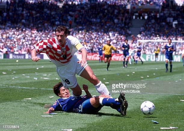 Football World Cup 1998 Croatia v Japan Davor Suker is tackled by Eisuke NAKANISHI