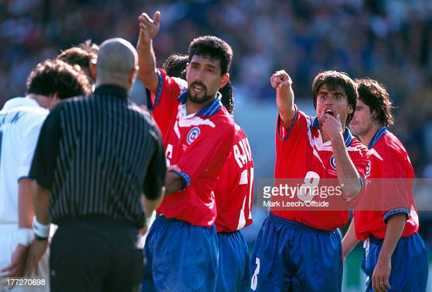 Football World Cup 1998 Italy v Chile Clarence Acuna and Pedro Reyes argue with referee Lucien Bouchardeau