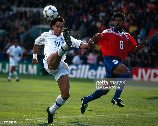 Football World Cup 1998 Italy v Chile Filippo Inzaghi clears from Pedro Reyes