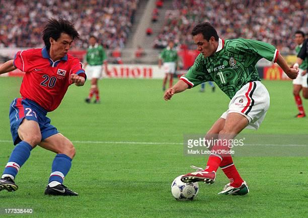 Football World Cup 1998 South Korea v Mexico Cuauhtemoc Blanco runs at Hong Myung Bo