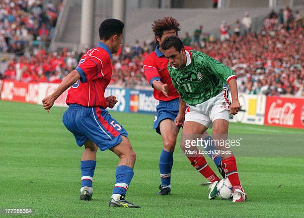 Football World Cup 1998 South Korea v Mexico Cuauhtemoc Blanco under pressure from Min Lee Sung