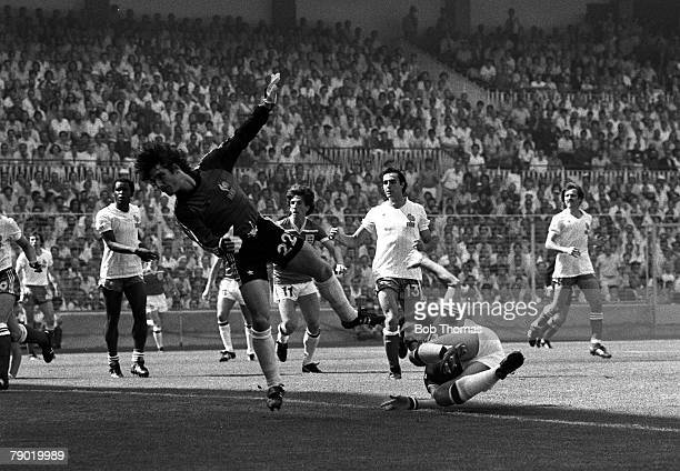 Football World Cup Finals Bilbao Spain Group Four 16th June 1982 England 3 v France 1 England's captain Bryan Robson shoots past French goalkeeper...