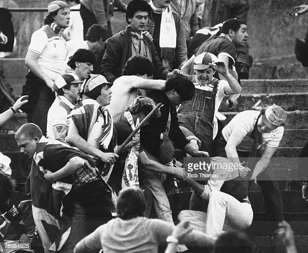 Football World Cup Qualifier Basle 30th May 1981 Switzerland 2 v England 1 A Swiss fan is stabbed in the back by an English hooligan during the...