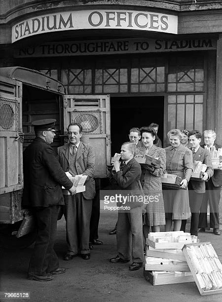 Football World War II 17th March 1945 Wembley England Wembley Stadium Box Office staff help to load 95000 tickets into a mail van for distribution...