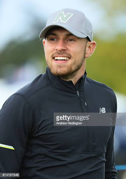 Footballer Aaron Ramsey looks on during the Hero ProAm at The Grove on October 12 2016 in Watford England