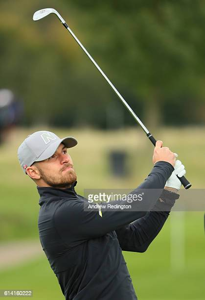 Footballer Aaron Ramsey plays a shot during the Hero ProAm at The Grove on October 12 2016 in Watford England