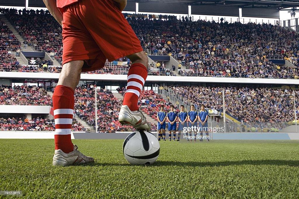 Footballer about to take a free kick : Stock Photo