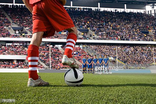 footballer about to take a free kick - defender soccer player stock photos and pictures