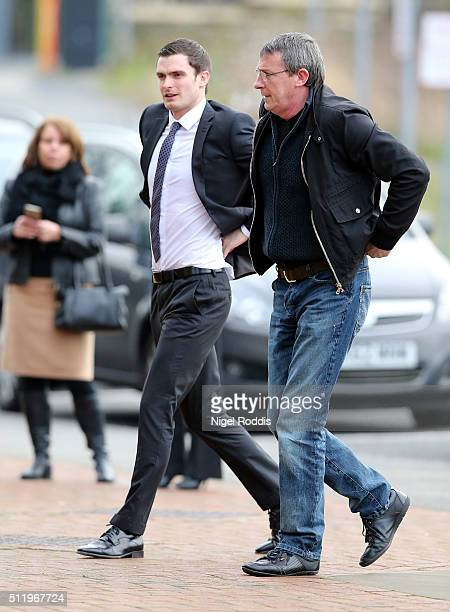 Footballer Adam Johnson arrives with his father Dave at Bradford Crown Court for day nine of the trial where he is facing child sexual assault...