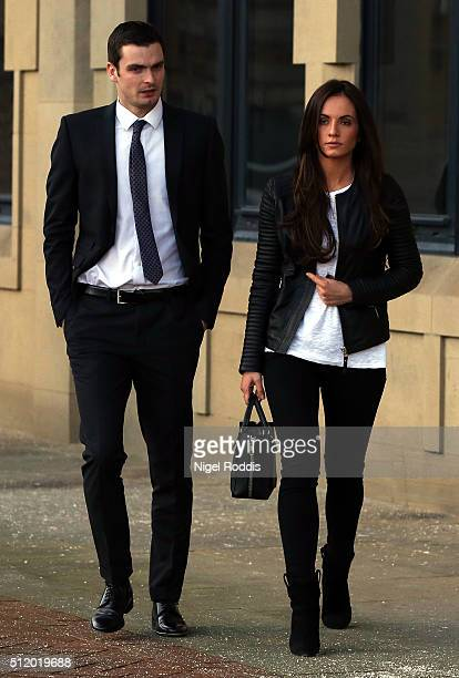 Footballer Adam Johnson leaves with partner Stacey Flounders at Bradford Crown Court for day nine of the trial where he is facing child sexual...