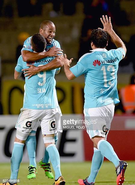 Footballer Alberto Rodriguez of Peru's team Sporting Cristal celebrates with teammates Santiago Silva and Renzo Revoledo after scoring the team's...