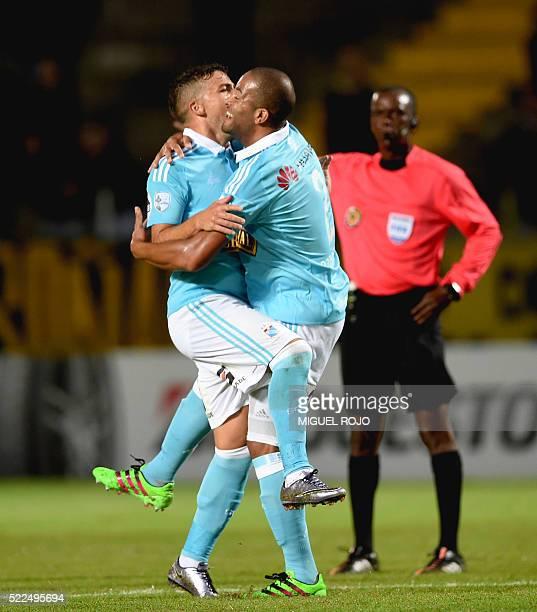 Footballer Alberto Rodriguez of Peru's team Sporting Cristal celebrates with teammate Irven Avila after scoring against Uruguay's Penarol during...