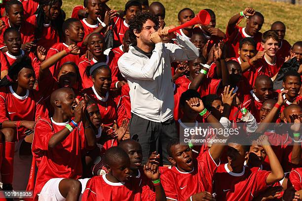 Footballer Alexandre Pato joins young footballers to celebrate the completion of the new NIKE community football training centre in Soweto on June 9...