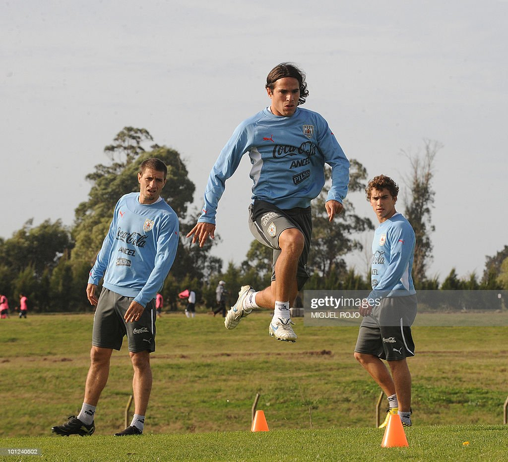 Footballer Alvaro Gonzalez (C) jumps during a training session of the Uruguayan national team in Canelones, near Montevideo, on May 28, 2010.