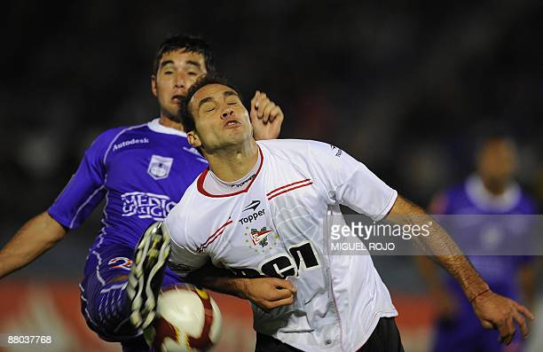 Footballer Alvaro Navarro of Uruguay's Defensor vies with Leandro Desabato of Argentina's Estudiantes during a Libertadores Cup match against on May...