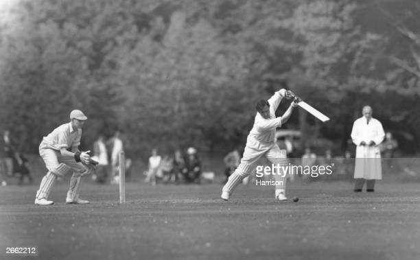 Footballer and England and Middlesex cricketer Denis Compton batting for the Forty Club Side against Eton College at Eton the first cricket match he...