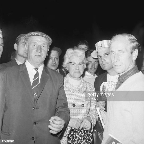 Footballer Bobby Charlton meets his parents Bob and Cissie Charlton outside the dressing room at Wembley Stadium during the 1966 World Cup in England...