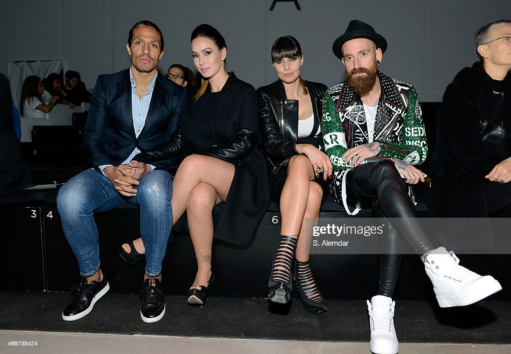 Footballer Bruno Alves, guest, footballer Raul Meireles and Ivone Meireles pose at the Hakan Akkaya show during Mercedes Benz Fashion Week Istanbul FW15 on March 18, 2015 in Istanbul, Turkey.