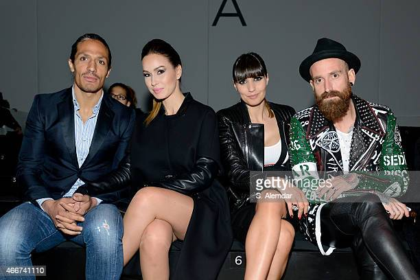 Footballer Bruno Alves guest footballer Raul Meireles and Ivone Meireles pose at the Hakan Akkaya show during Mercedes Benz Fashion Week Istanbul...