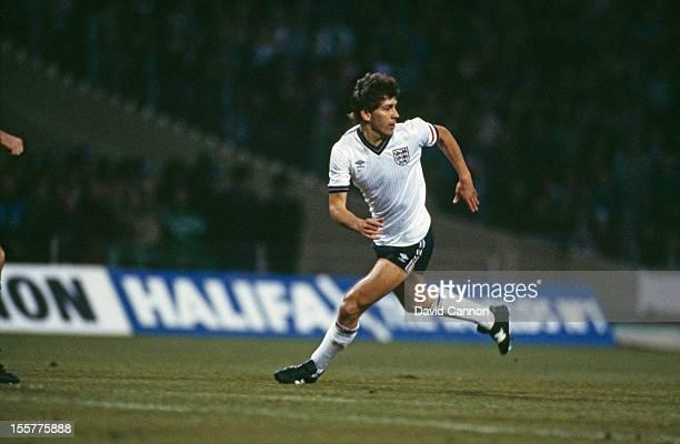 Footballer Bryan Robson in action for England circa 1985