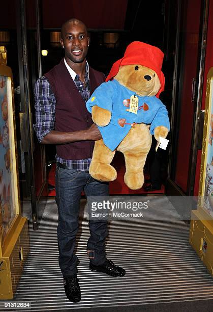 Footballer Carlton Cole attends the launch of iPod skins by Wrappz in aid of Children In Need at Hamleys on October 1 2009 in London England