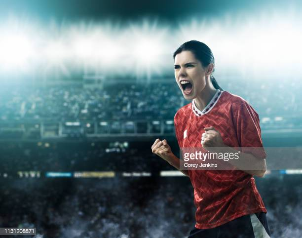 footballer celebrating goal - scoring a goal stock pictures, royalty-free photos & images