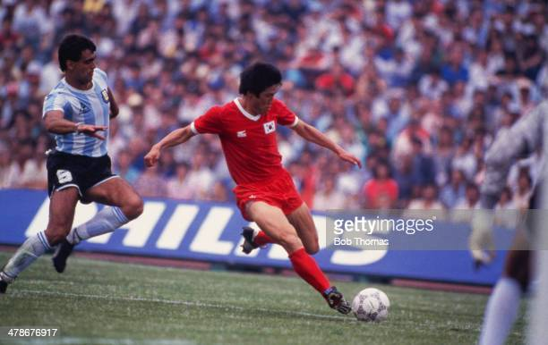 Footballer Cha BumKun of South Korea under pressure from Jose Brown of Argentina in a FIFA World Cup first round match at Estadio Olimpico...