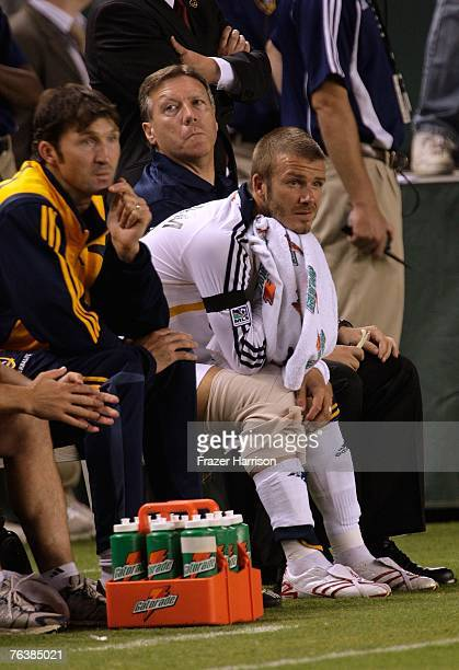 Footballer David Beckham captain of the Los Angeles Galaxy sits injured on the sidelines during their SuperLiga Final match gainst Pachuca at the...