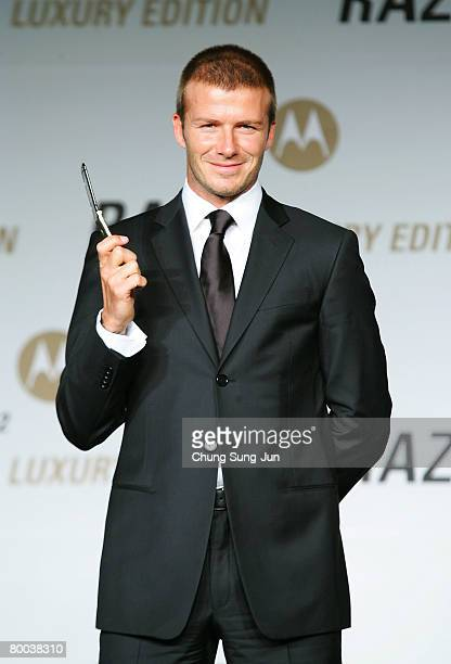Footballer David Beckham holds Motorola's mobile phone 'Luxury Gold' RAZR2 during a promotion for Motorola at the Westin Chosun Hotel on February 28...