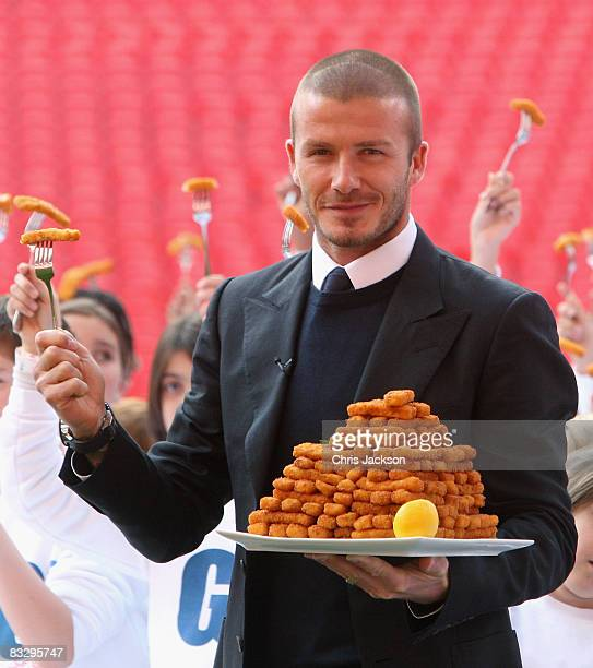 Footballer David Beckham poses with children as he launches the new GO3 food range at Wembley Stadium on October 16, 2008 in London, England.