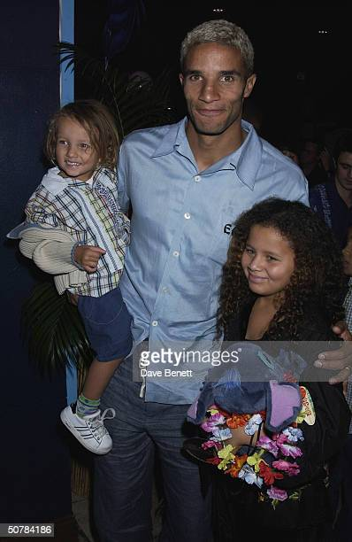 Footballer David James and his daughters at the UK premiere of Disney's 'Lilo and Stitch' held at the Odeon Leicester Square on 28th September 2002...