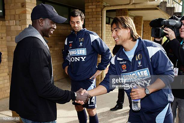Footballer Dwight Yorke meets Nick Carle during a meet and greet with his Sydney FC teammates ahead of the Sydney FC v Everton Tour Down Under match...