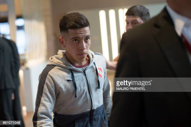 Footballer Ezequiel Barco of Argentina's Independiente walks in the lobby of the Hilton Barra hotel in Rio de Janeiro Brazil where the squad is...