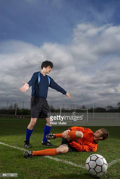 footballer fouled by another player