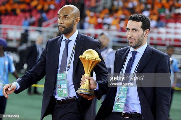 Footballer Frederic Kanoute and Egyptian midfielder Mohamed Aboutrika deliver the 2015 African Cup of Nations trophy ahead of the final football...