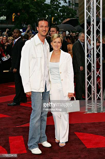 Footballer Fredi Bobic and wife Britta at European premiere of War of the Worlds In the theater at Potsdamer Platz in Berlin