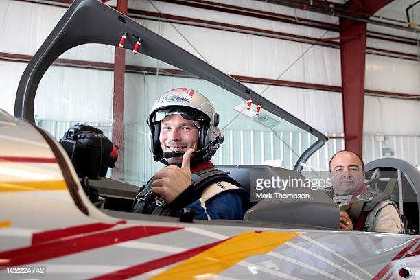 Footballer Fredrik Ljungberg of Sweden with pilot Sergio Pla before his media flight at the Race Airport during the Red Bull Air Race New York...