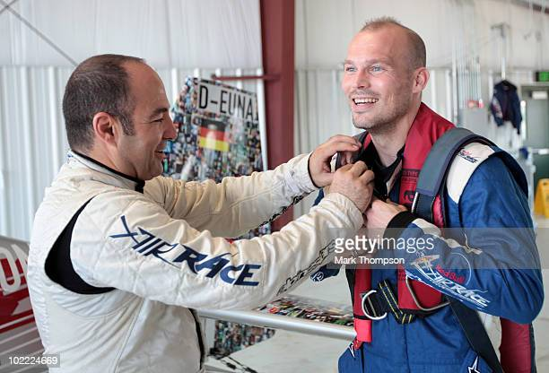 Footballer Fredrik Ljungberg of Sweden with pilot Sergio Pla prepares for his media flight at the Race Airport during the Red Bull Air Race New York...