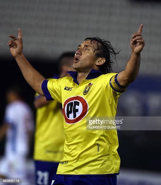 Footballer Gabriel Vargas of Chile's Universidad de Concepcion celebrates after scoring against Paraguay's Nacional during a Copa Sudamericana match...