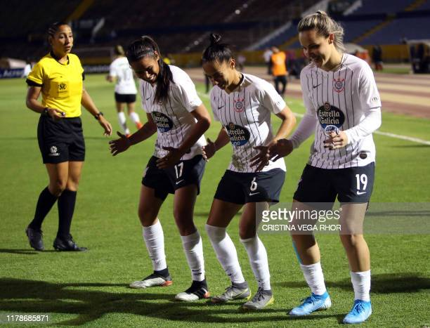 Footballer Giovanna Crivelari Anselmo of Brazil's Corinthians celebrates with teammates after scoring against Brazil's Ferroviaria during the women's...
