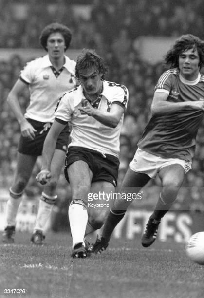 Footballer Glenn Hoddle playing for Tottenham Hotspur FC in a match against Birmingham City