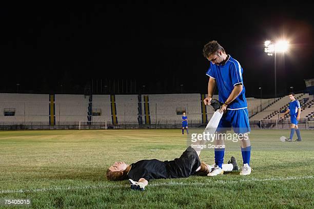 Portero Footballer ayudar